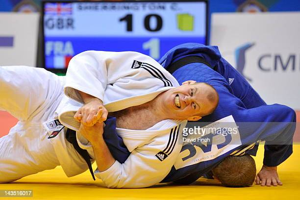 Chris Sherrington of Great Britain tries to armlock former European champion Matthieu Bataille of France in their day 3 elimination contest at the...