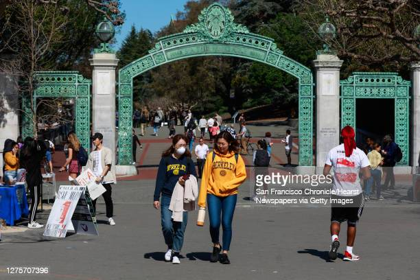 Chris Shi, 21 wears a mask while chatting with Monica G. On the UC Berkeley campus on Wednesday, March 4, 2020 in Berkeley, California. A state audit...