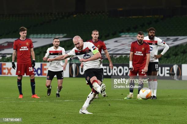 Chris Shields of Dundalk FC scores their sides first goal from the penalty spot during the UEFA Europa League Group B stage match between Dundalk FC...