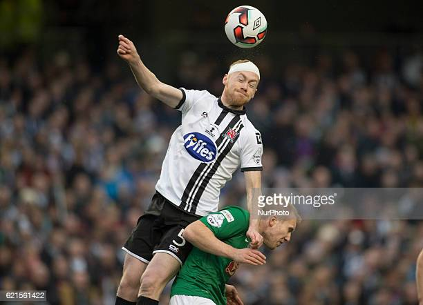 Chris Shields of Dundalk jumps for the ball during the Irish Daily Mail FAI Senior Cup Final 2016 match between Cork City and Dundalk FC at Aviva...