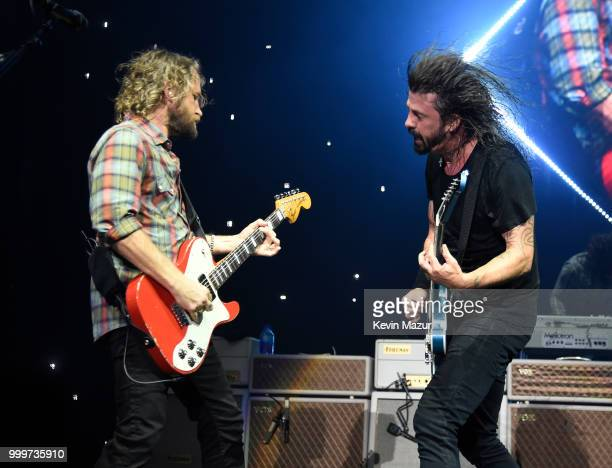 Chris Shiflett and Dave Grohl of Foo Fighters perform on stage during their Concrete and Gold tour at Northwell Health at Jones Beach Theater on July...