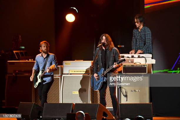 Chris Shiflett Dave Grohl and Rami Jaffee of Foo Fighters perform onstage during MusiCares Person of the Year honoring Aerosmith at West Hall at Los...