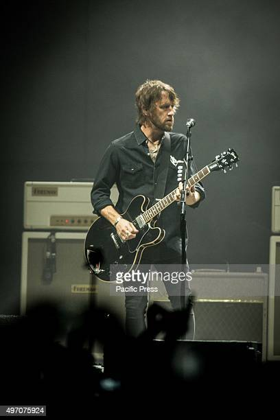 Chris Shiflett of the american rock band Foo Fighters pictured on stage as he performs live at Unipol Arena Bologna Foo Fighters is an American rock...