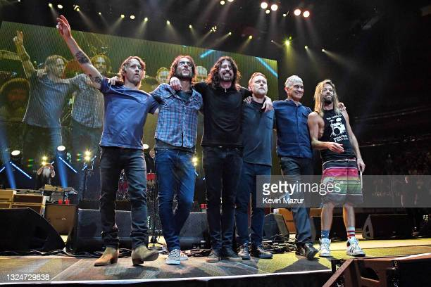 Chris Shiflett, Rami Jaffee, Dave Grohl, Nate Mendel, Pat Smear and Taylor Hawkins pose onstage as The Foo Fighters reopen Madison Square Garden on...