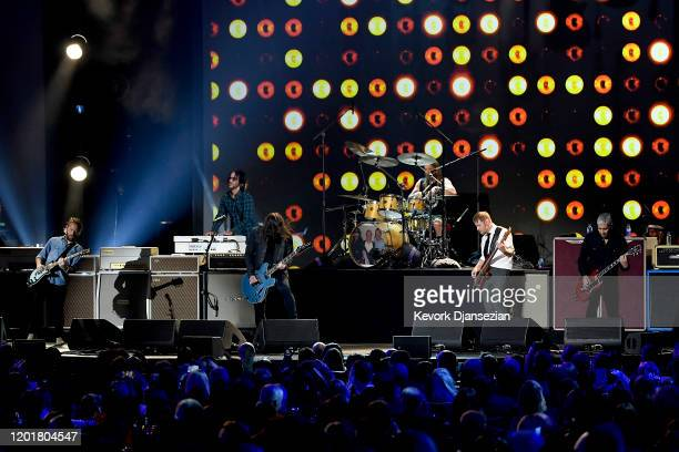 Chris Shiflett Rami Jaffee Dave Grohl Taylor Hawkins Nate Mendel and Pat Smear of Foo Fighters perform onstage at MusiCares Person of the Year...
