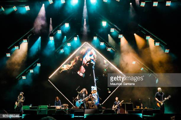 Chris Shiflett Rami Jaffee Dave Grohl Taylor Hawkins Nate Mendel and Pat Smear members of the band Foo Fighters performs live on stage at Allianz...