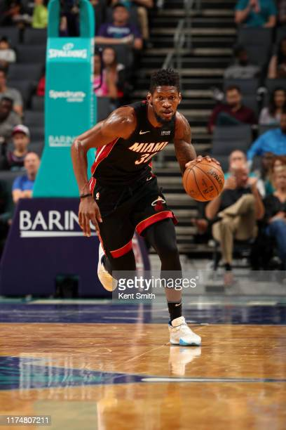Chris Silva of the Miami Heat handles the ball against the Charlotte Hornets during a preseason game on October 9 2019 at Spectrum Center in...