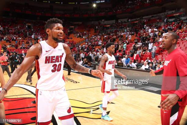 Chris Silva of the Miami Heat highfives Davon Reed of the Miami Heat after the game against the San Antonio Spurs on October 8 2019 at American...