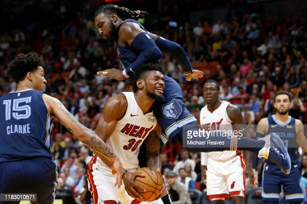 Chris Silva of the Miami Heat is fouled by Jae Crowder and Brandon Clarke of the Memphis Grizzlies during the second half at American Airlines Arena...