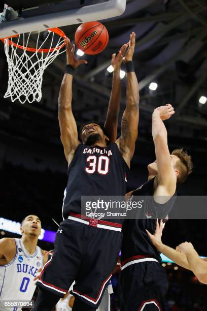 Chris Silva of the South Carolina Gamecocks battles for a rebound in the first half against the Duke Blue Devils during the second round of the 2017...
