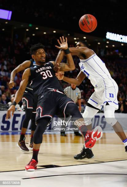 Chris Silva of the South Carolina Gamecocks battles for the ball with Amile Jefferson of the Duke Blue Devils in the first half during the second...