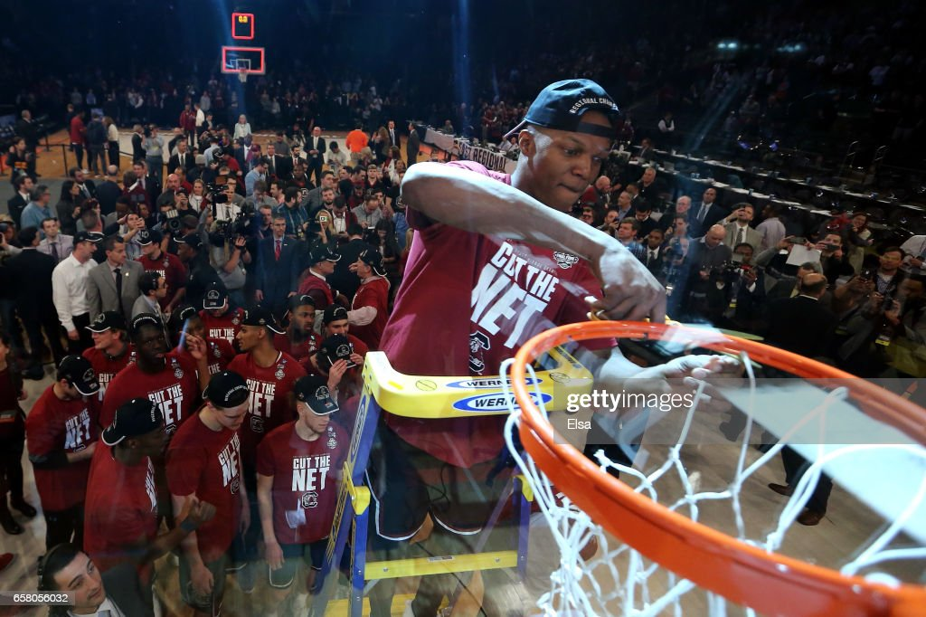Chris Silva #30 of the South Carolina Gamecocks celebrates by cutting down the net after defeating the Florida Gators with a score of 77 to 70 to win the 2017 NCAA Men's Basketball Tournament East Regional at Madison Square Garden on March 26, 2017 in New York City.