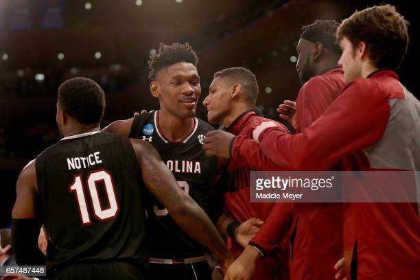 Chris Silva of the South Carolina Gamecocks celebrates with his teammates after being taken out of the game late in the second half against the...