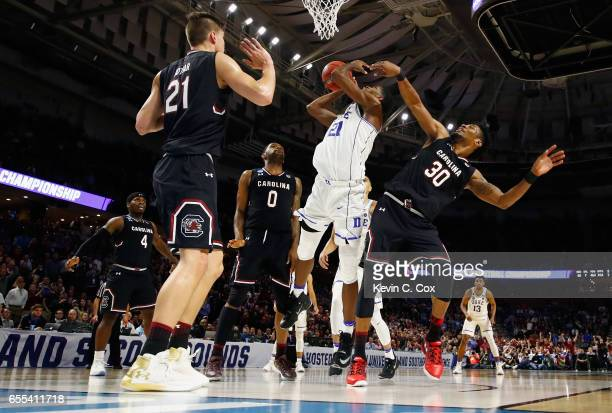 Chris Silva of the South Carolina Gamecocks defends Amile Jefferson of the Duke Blue Devils in the second half during the second round of the 2017...