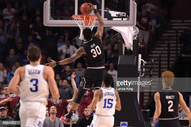Chris Silva of the South Carolina Gamecocks goes up for a dunk against the Duke Blue Devils during the second round of the 2017 NCAA Men's Basketball...