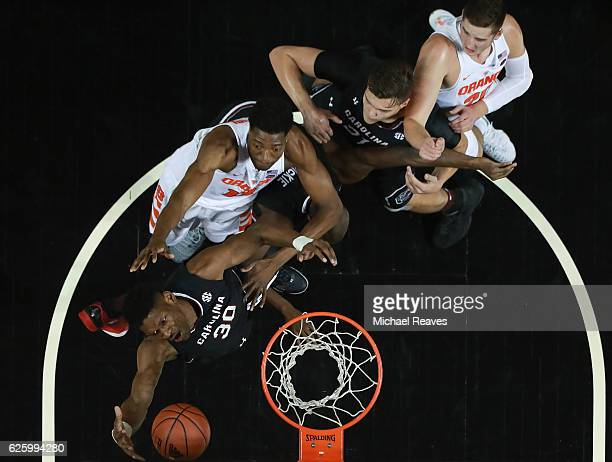 Chris Silva of the South Carolina Gamecocks grabs a rebound against Paschal Chukwu of the Syracuse Orange during the Brooklyn Hoops Holiday...