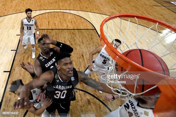 Chris Silva of the South Carolina Gamecocks hits Przemek Karnowski of the Gonzaga Bulldogs eye after a play during the 2017 NCAA Men's Final Four...