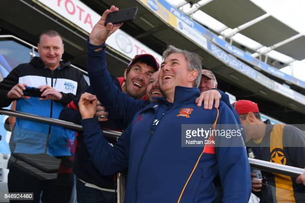 Chris Silverwood head coach of Essex poses for a selfie with fans after the County Championship Division One match between Warwickshire and Essex at...