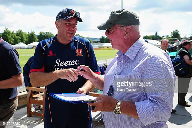 Chris Silverwood Head Coach of Essex signs autographs for a fan during Day Two of the Specsavers County Championship Division Two match between...