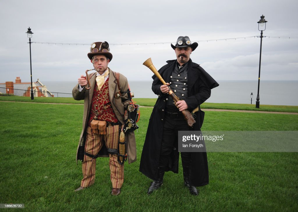 Chris Simpson(L), and Wayne Ellis, both from Chesterfield visit the Goth weekend dressed as steampunks on November 2, 2013 in Whitby, England. The Whitby Gothic Weekend that takes place in the Yorkshire seaside town twice yearly in Spring and Autumn started in 1994 and sees thousands of extravagantly dressed followers of Victoriana, Steampunk, Cybergoth and Romanticism visit to take part in celebrating Gothic culture.