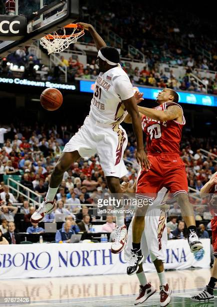 Chris Singleton of the Florida State Seminoles dunks in front of Johnny Thomas of the North Carolina State Wolfpack in their quarterfinal game in the...