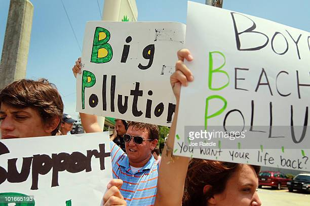 Chris Slick and others protest against the BP oil company in front of a BP gas station as oil continues to flow from the Deepwater Horizon oil spill...