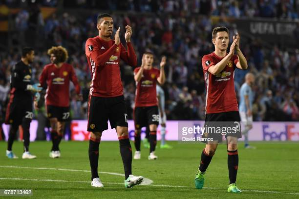 Chris Smalling and Ander Herrera of Manchester United celebrate victory after the UEFA Europa League semi final first leg match between Celta Vigo...