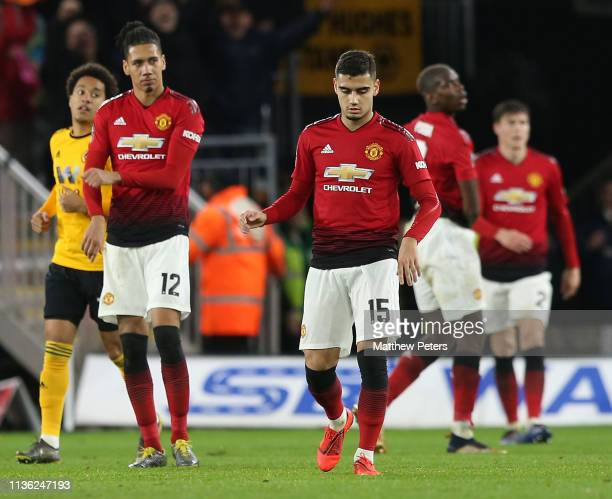 Chris Smalling and Andreas Pereira of Manchester United show their disappointment after the FA Cup Quarter Final match between Wolverhampton...