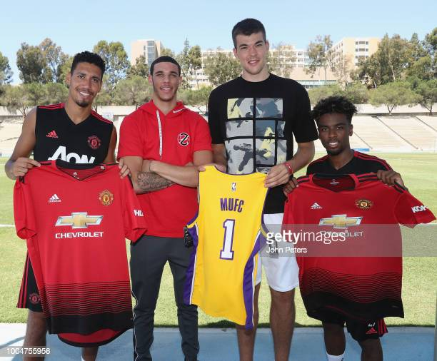 Chris Smalling and Angel Gomes of Manchester United swap shirts with Lonzo Ball and Ivica Zubac of LA Lakers after a first team training session at...