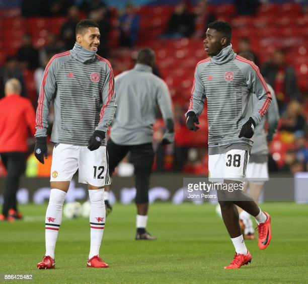 Chris Smalling and Axel Tuanzebe of Manchester United warm up ahead of the UEFA Champions League group A match between Manchester United and CSKA...