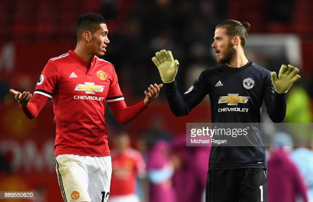 Chris Smalling and David De Gea of Manchester United react after the Premier League match between Manchester United and Manchester City at Old...