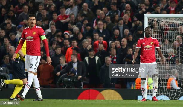 Chris Smalling and Eric Bailly of Manchester United react to conceding a second goal during the UEFA Champions League Round of 16 Second Leg match...