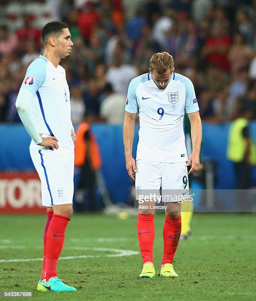 Chris Smalling and Harry Kane of England show their dejection after their defeat in the UEFA EURO 2016 round of 16 match between England and Iceland...