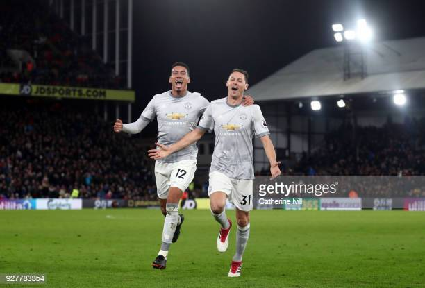 Chris Smalling and Nemanja Matic of Manchester United celebrate during the Premier League match between Crystal Palace and Manchester United at...