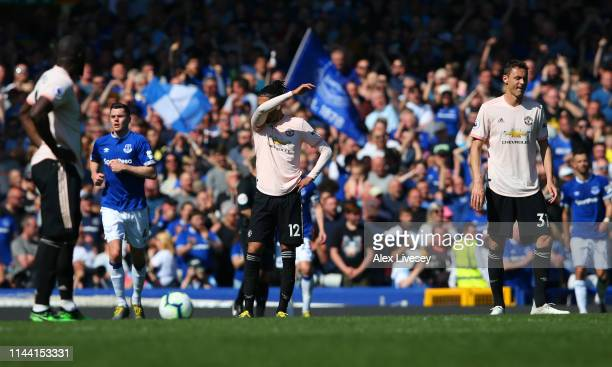 Chris Smalling and Nemanja Matic of Manchester United look dejected during the Premier League match between Everton FC and Manchester United at...