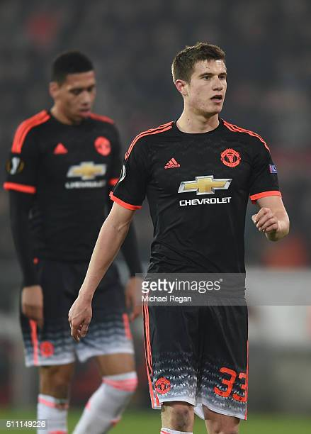 Chris Smalling and Paddy McNair of Manchester United are seen during the UEFA Europa League round of 32 first leg match between FC Midtjylland and...