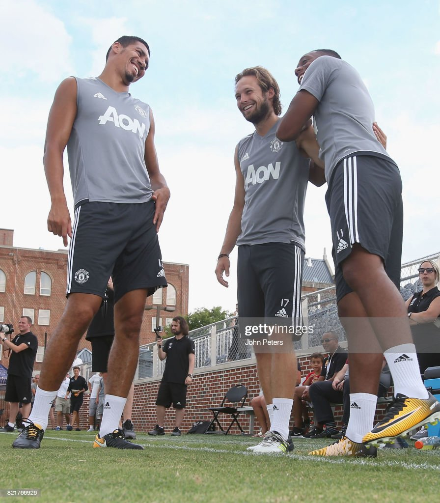 Chris Smalling, Daley Blind and Anthony Martial of Manchester United in action during a first team training session as part of their pre-season tour of the USA at Shaw Field on July 24, 2017 in Washington, DC.