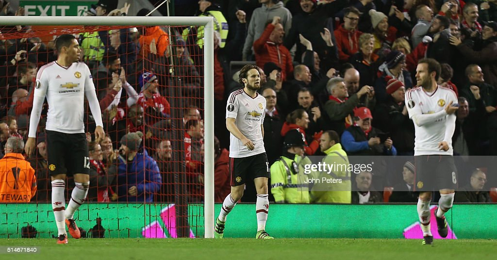 Chris Smalling, Daley Blind and Juan Mata of Manchester United react to Daniel Sturridge of Liverpool scoring their first goal during the UEFA Europa League round of 16 first leg match between Liverpool and Manchester United at Anfield on March 10, 2016 in Liverpool, United Kingdom.