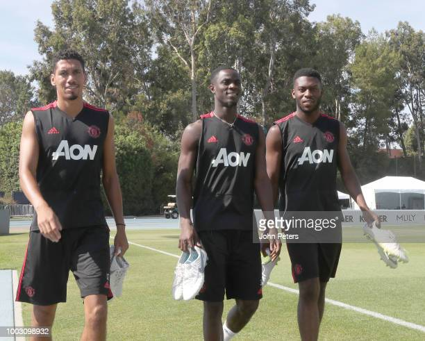 Chris Smalling Eric Bailly and Timothy FosuMensah of Manchester United in action during a first team training session as part of their preseason tour...
