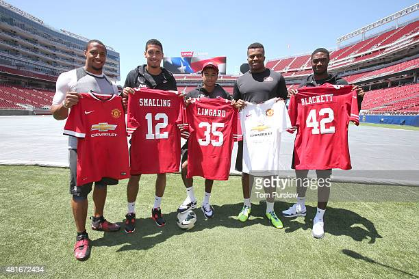 Chris Smalling, Jesse Lingard and Tyler Blackett of Manchester United meet Lawrence Okoye and Eric Reid of the San Francisco 49ers during a meet and...