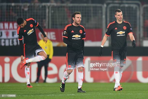 Chris Smalling Juan Mata and Morgan Schneiderlin of Manchester United react after Midtjylland's second goal during the UEFA Europa League round of 32...