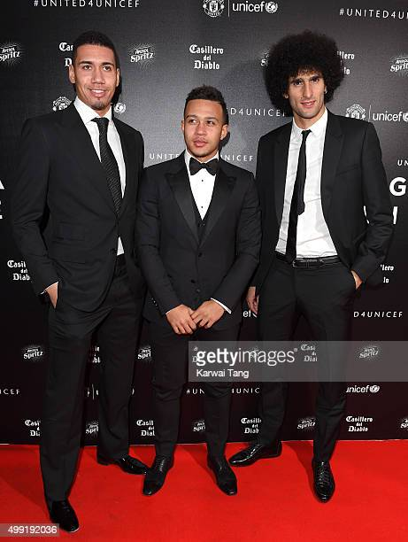 Chris Smalling Memphis Depay and Marouane Fellaini attend the United for UNICEF Gala Dinner at Old Trafford on November 29 2015 in Manchester England