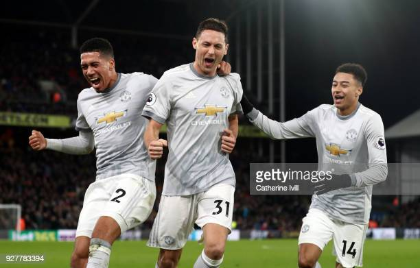 Chris Smalling Nemanja Matic and Jesse Lingard of Manchester United celebrate during the Premier League match between Crystal Palace and Manchester...