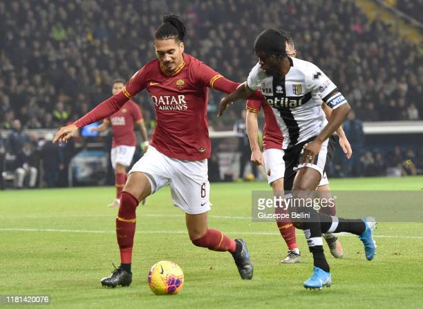 Chris Smalling of AS Roma and Gervinho of Parma Calcio in action during the Serie A match between Parma Calcio and AS Roma at Stadio Ennio Tardini on...