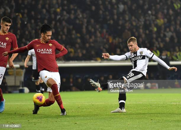Chris Smalling of AS Roma and Riccardo Gagliolo of Parma Calcio in action during the Serie A match between Parma Calcio and AS Roma at Stadio Ennio...