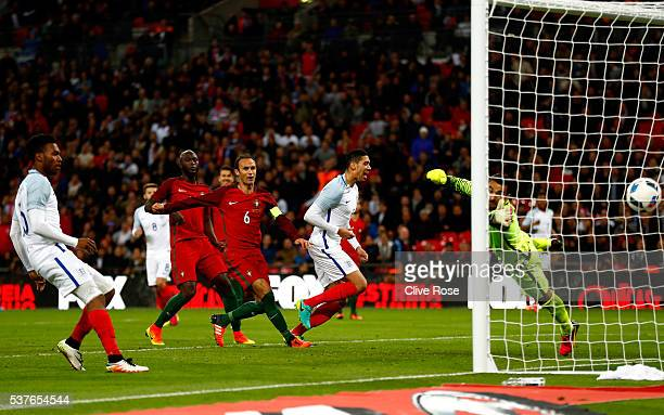Chris Smalling of England beats goalkeeper Rui Patricio of Portugal as he scores their first goal during the international friendly match between...