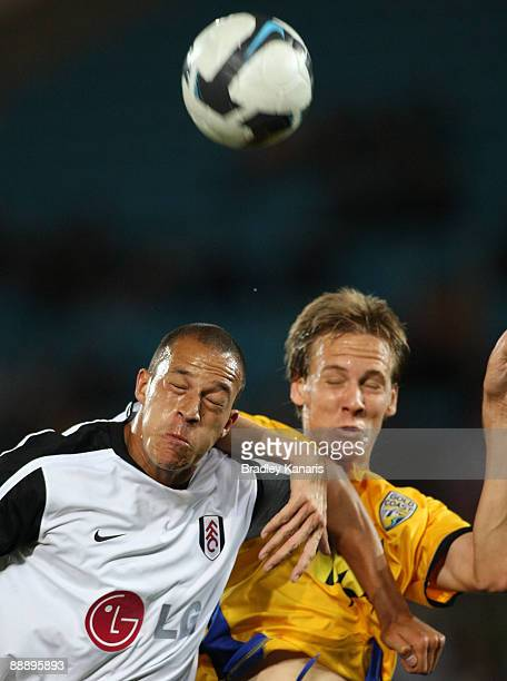 Chris Smalling of Fulham and Michael Thwaite of United compete for the ball during the exhibition football match between Gold Coast United and Fulham...
