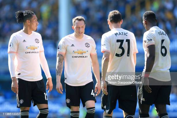 Chris Smalling of Man Utd and Phil Jones of Man Utd look dejected during the Premier League match between Everton and Manchester United at Goodison...