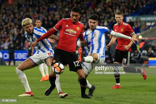 Chris Smalling of Man Utd battles with Philip Billing of Huddersfield and Christopher Schindler of Huddersfield during The Emirates FA Cup Fifth...