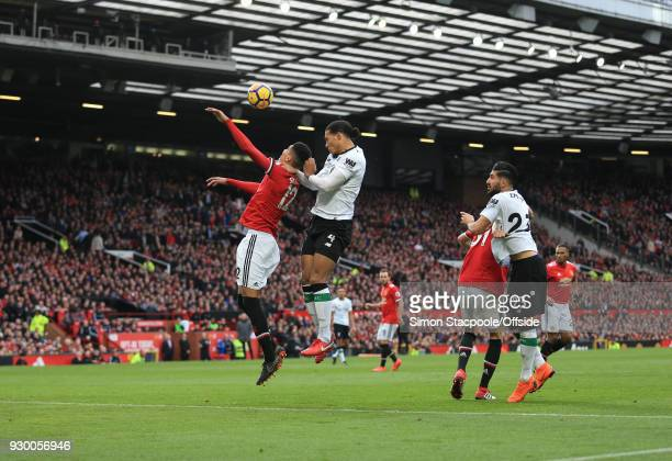 Chris Smalling of Man Utd is beaten to the ball by Virgil van Dijk of Liverpool during the Premier League match between Manchester United and...